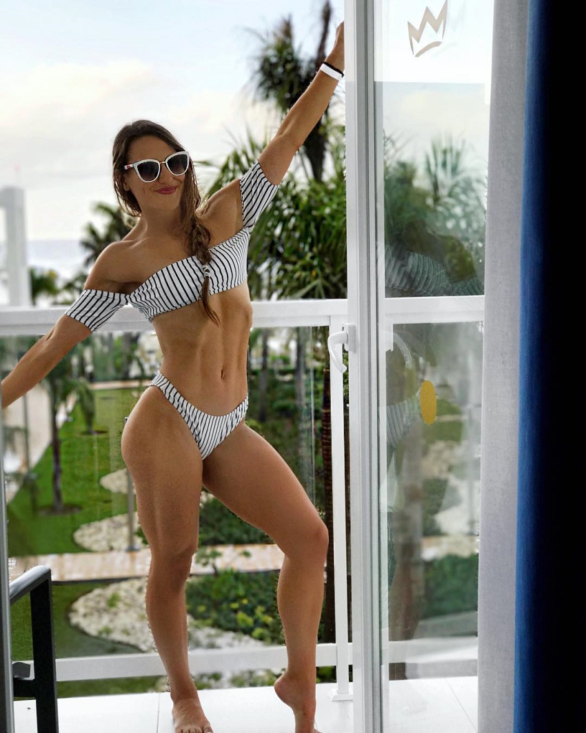 Michele Sullivan standing on a balcony looking fit and healthy