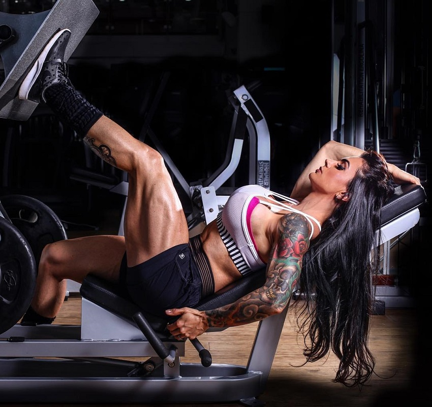 Renata Costa doing heavy leg presses her legs looking ripped and muscular