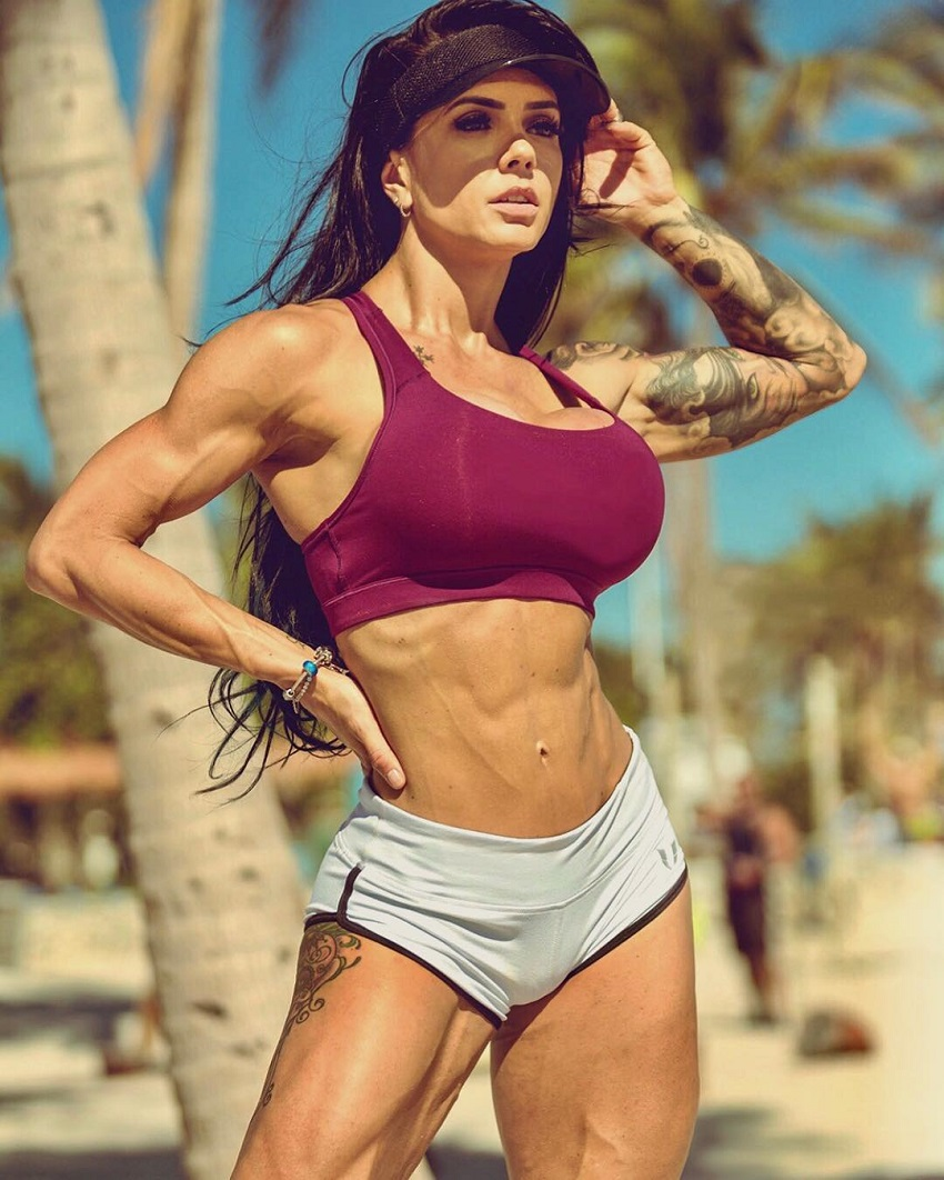 Renata Costa posing in a photo shoot on a beach looking fit and lean