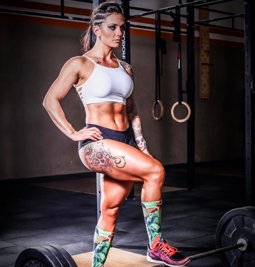Renata Costa posing for a photo in a gym looking strong and fit