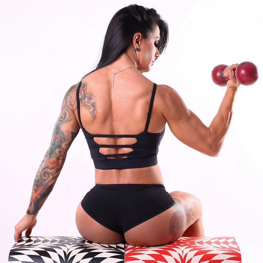 Renata Costa lifting a dumbbell looking fit and lean from the back