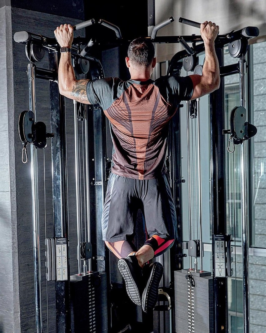 Rob Sharpe doing pull-ups in a gym