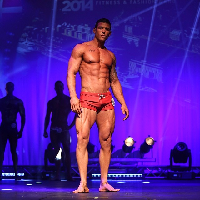 Rob Sharpe standing on the WBFF stage