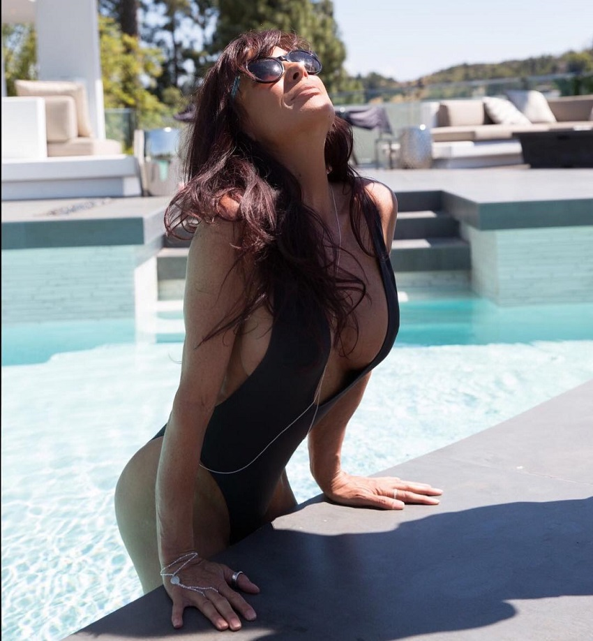 Shannon Ray stretching by the edge of a pool looking healthy and fit