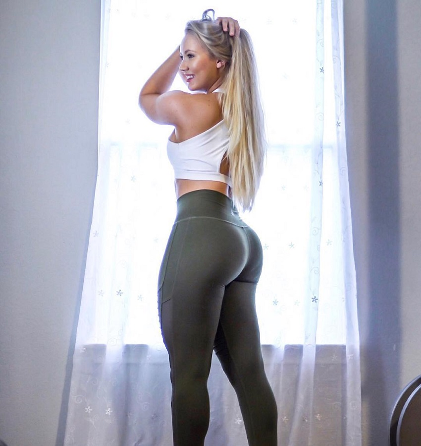 Shae LaShae standing in her green leggings looking curvy and fit