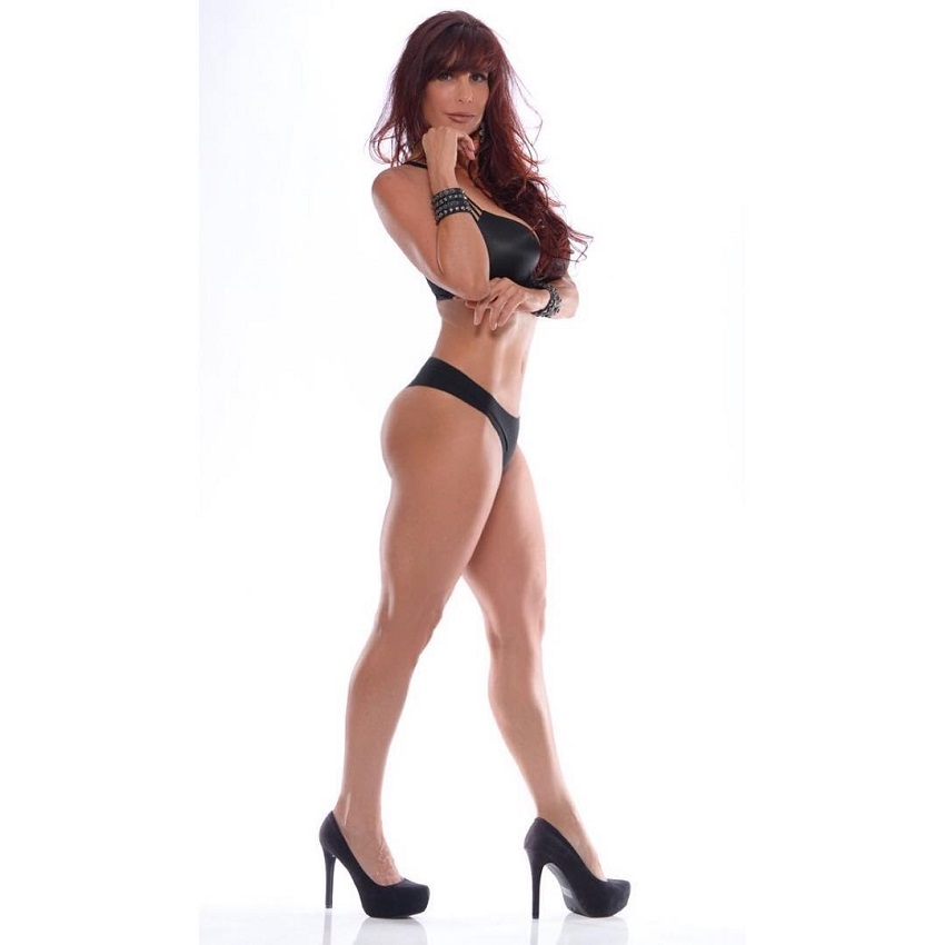 Shannon Ray standing in her heels looking fit and lean