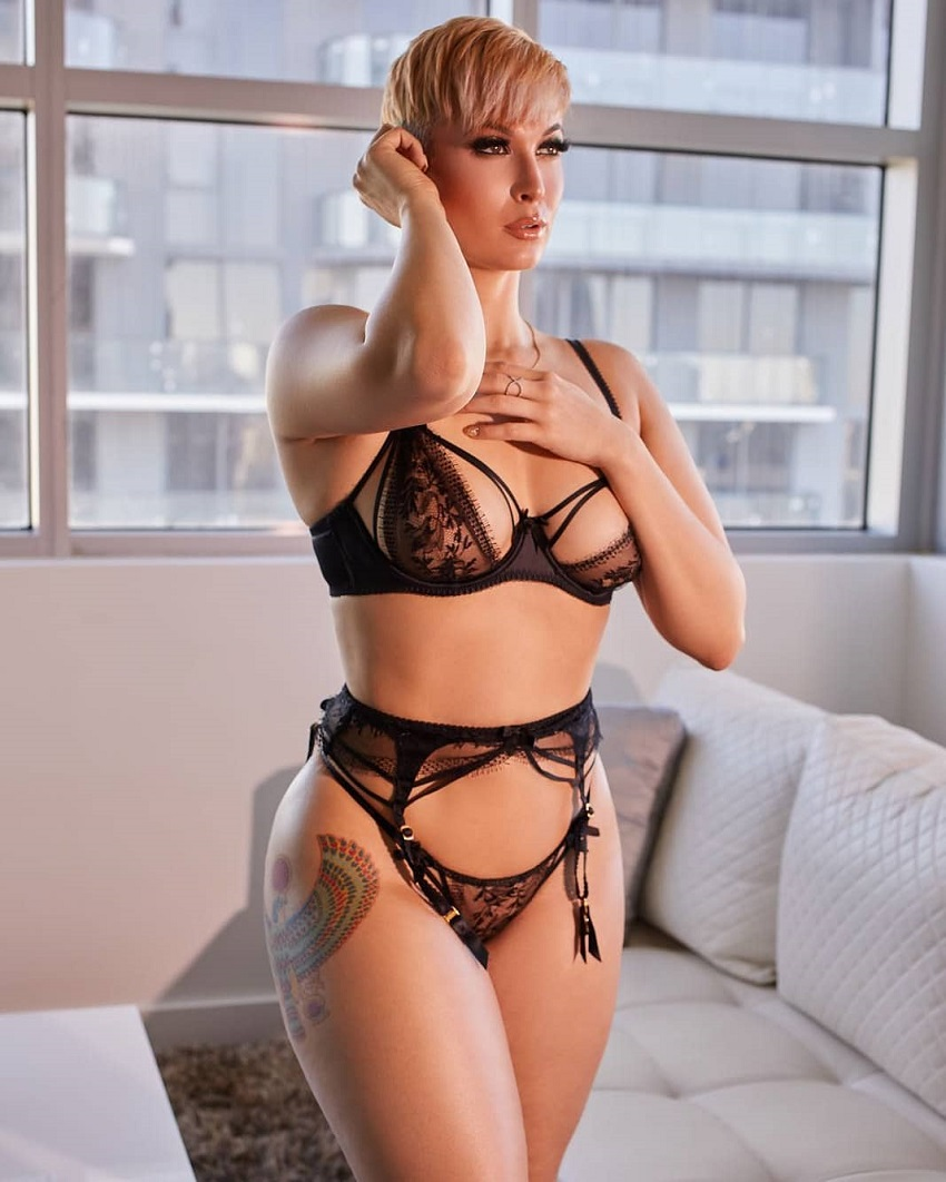 Zahra Elise posing in black lingerie looking fit and lean
