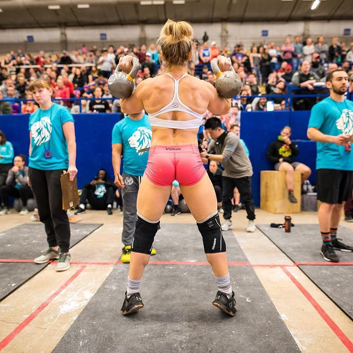 Alexis Johnson standing in front of a massive crowd during a CrossFit competition
