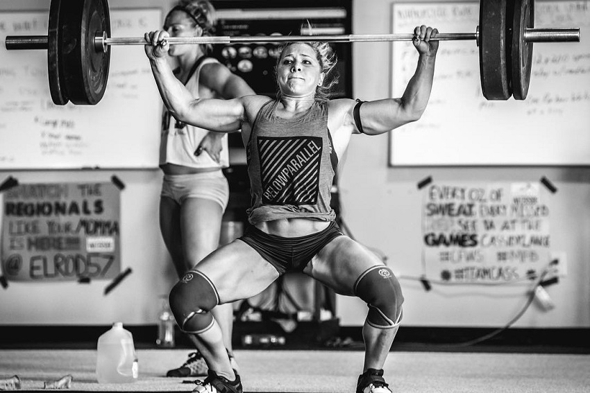 Alexis Johnson doing a heavy overhead press during CrossFit training