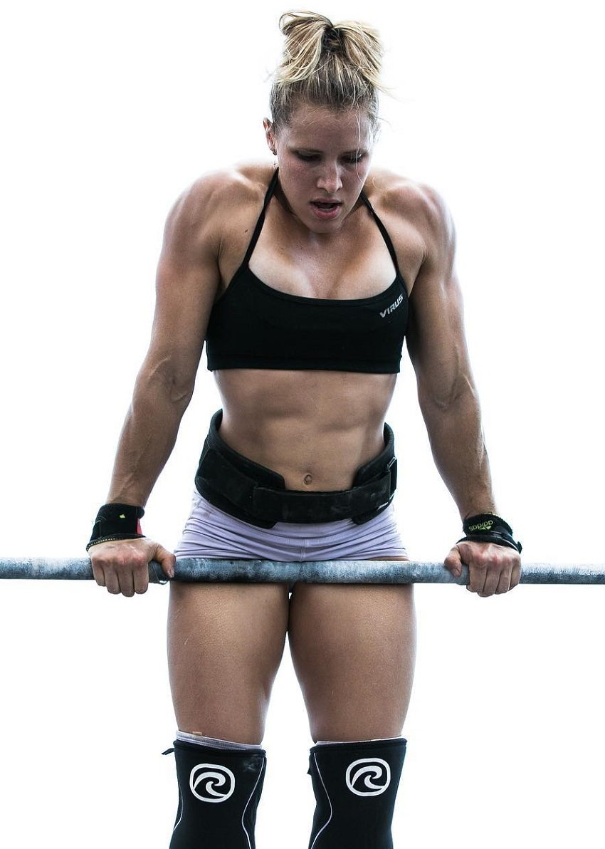 Alexis Johnson performing an exercise on a pull-up bar