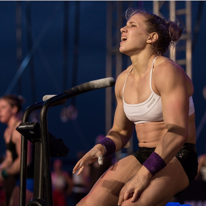 Alexis Johnson sitting during a CrossFit contest with a pained expression on her face