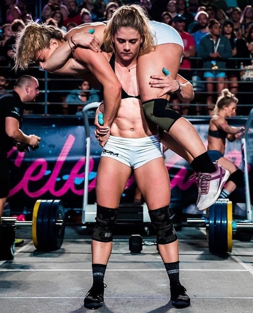 Alison Scudds carrying another CrossFit athlete during a competition