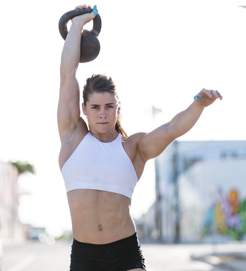 Alison Scudds lifting a kettlebell over her head