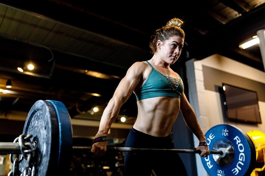 Alison Scudds lifting a barbell loaded with weights