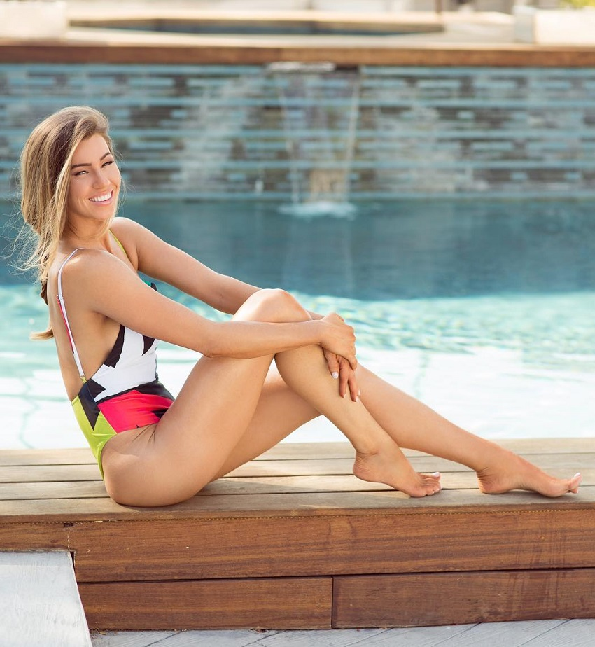 Anna Victoria sitting by the pool looking fit and lean