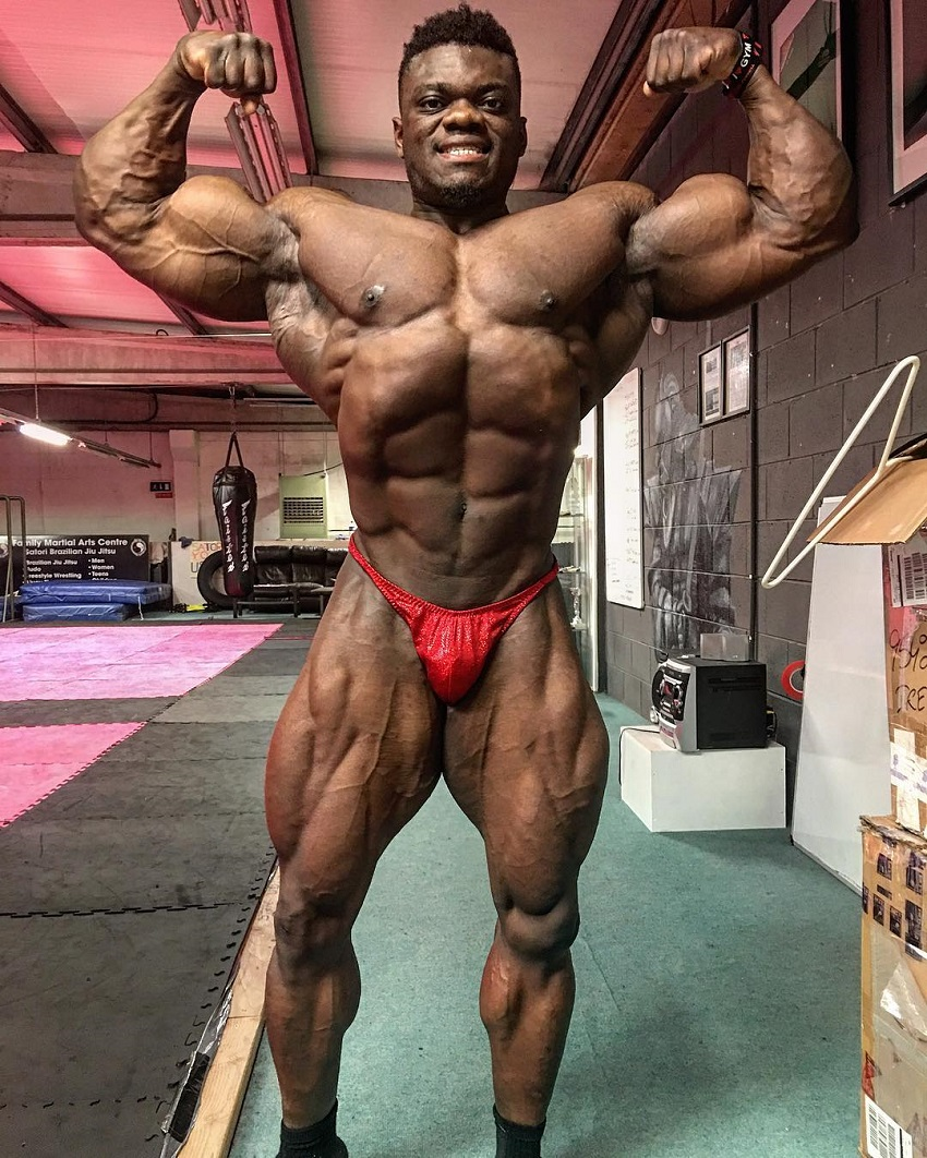 Blessing Awodibu doing a front double biceps pose in a photo