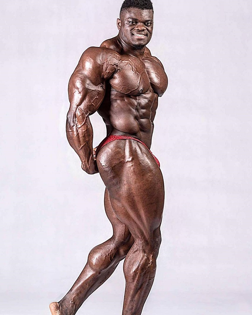 Blessing Awodibu doing a side triceps pose in a professional photo shoot