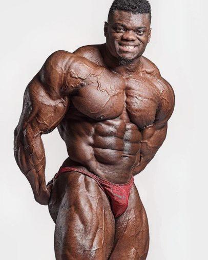 Blessing Awodibu flexing shirtless in a photo shoot