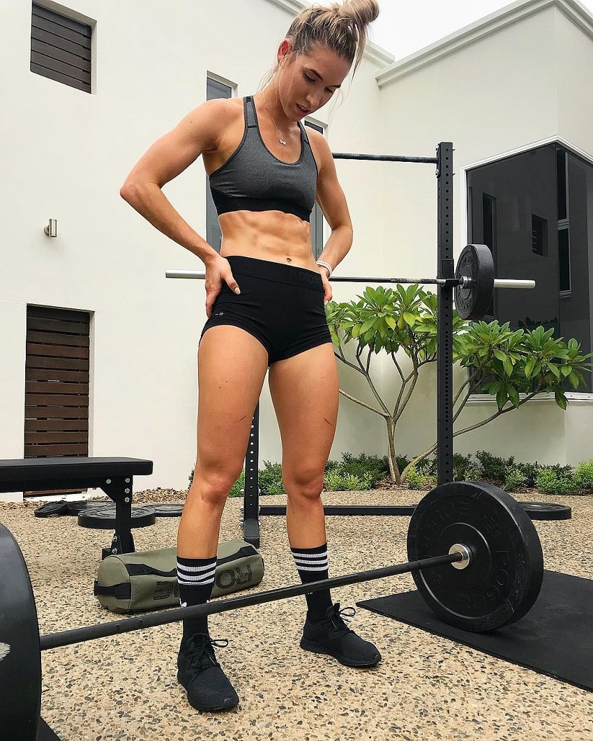 Cass Olholm preparing to do a heavy barbell exercise