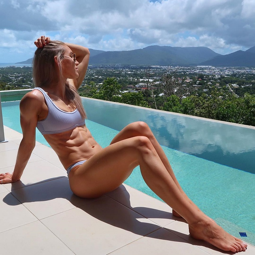 Cass Olholm lying by the pool looking fit and lean