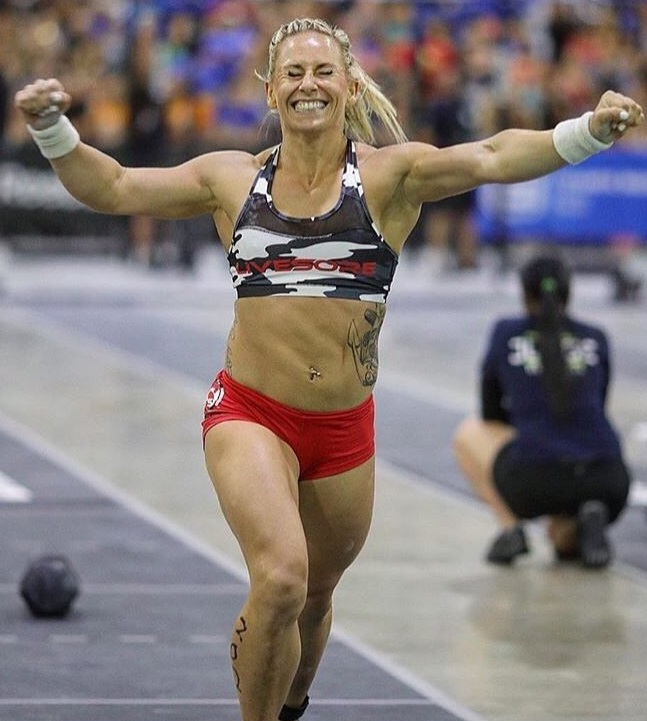 Cassidy Lance-Mcwherter running any smiling during a CrossFit contest, happy with her result