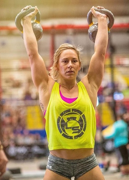 Cassidy Lance-Mcwherter doing an overhead kettlebell press during a CrossFit competition