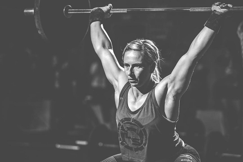Cassidy Lance-Mcwherter lifting a heavy barbell during a photo shoot