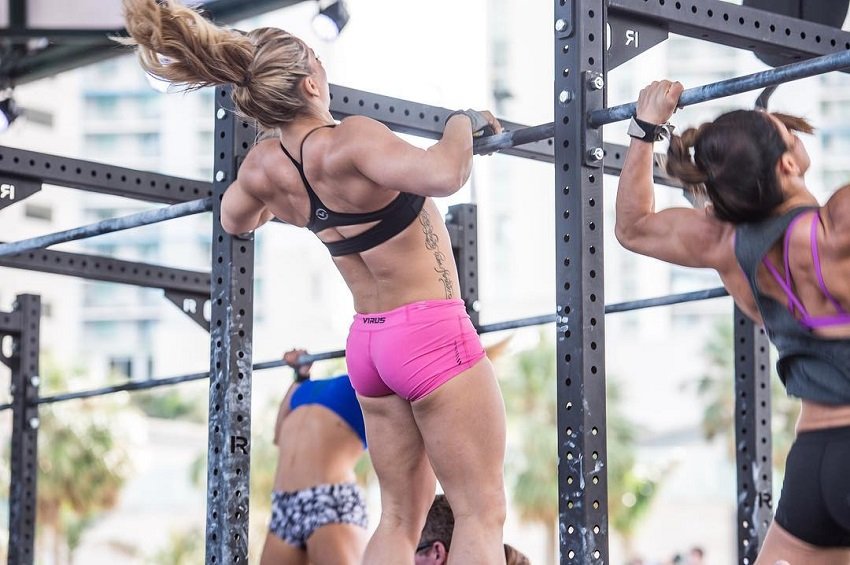 Cassidy Lance-Mcwherter performing pull ups during a CrossFit contest looking muscular
