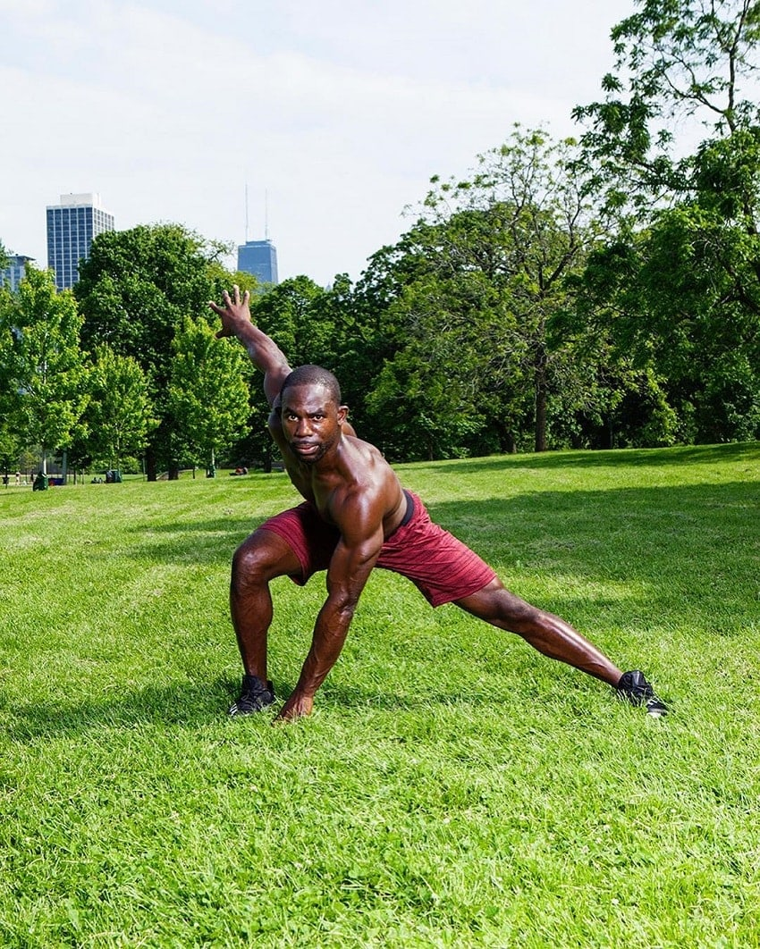Gideon Akande training outdoors on the grass