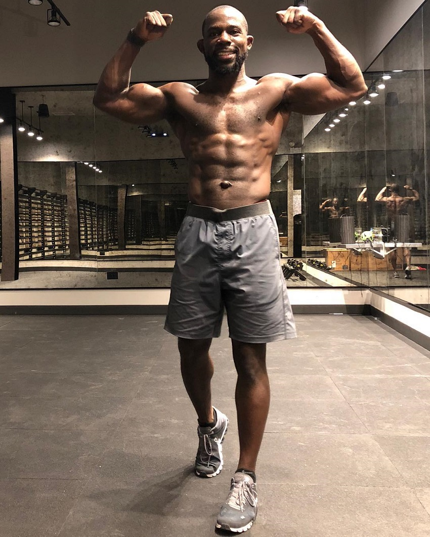 Gideon Akande flexing his biceps for a photo