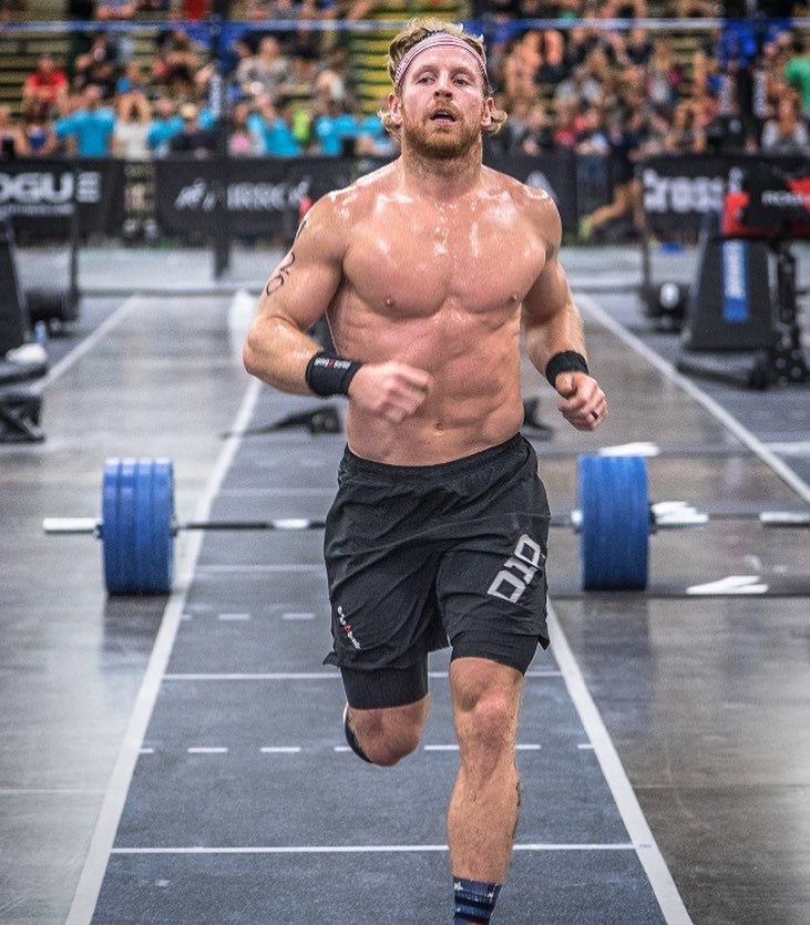 Graham Holmberg running shirtless during a CrossFit contest