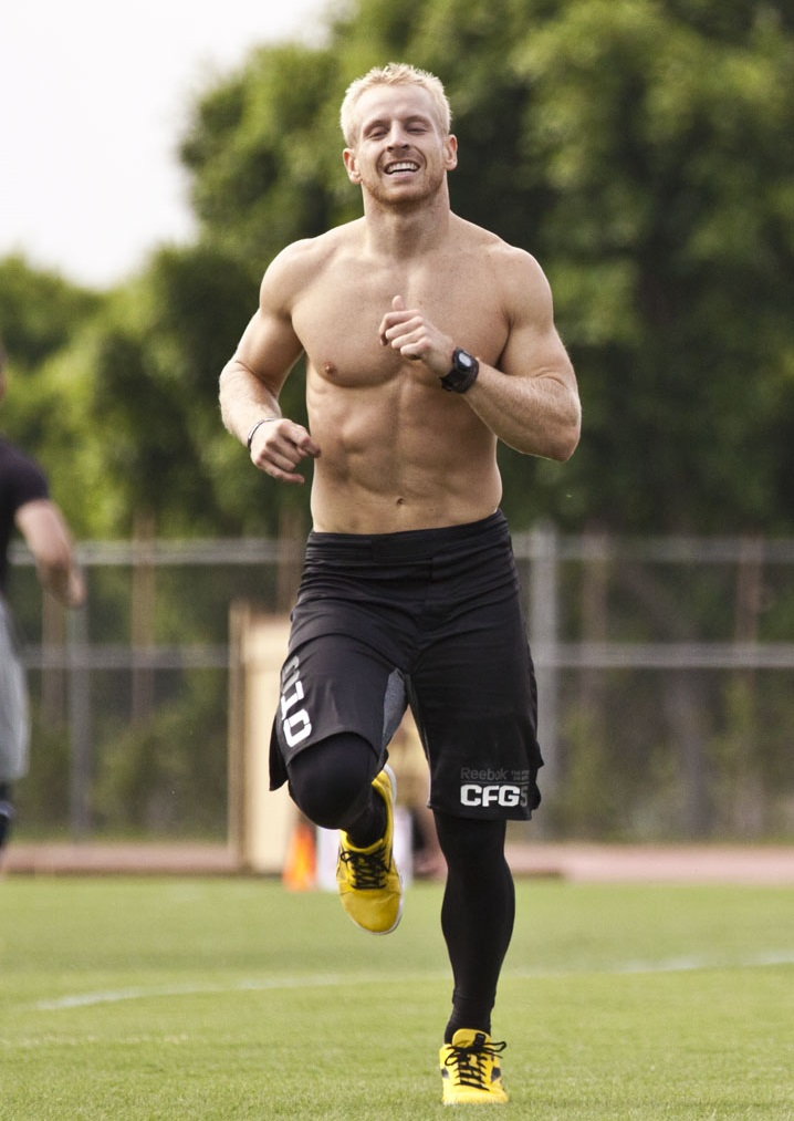 Graham Holmberg running outdoors looking fit and lean