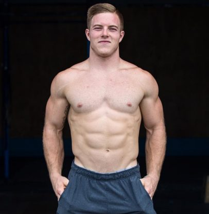 Noah Ohlsen posing shirtless for a photo looking fit and strong