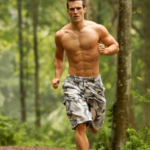 Scott Baptie running shirtless in the woords