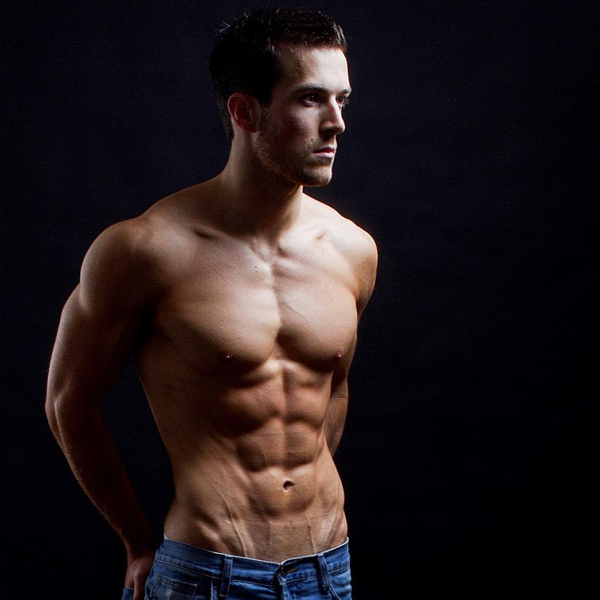 Scott Baptie posing shirtless in a photo shoot