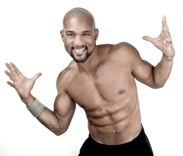 Shaun T posing shirtless in a professional fitness photo shoot
