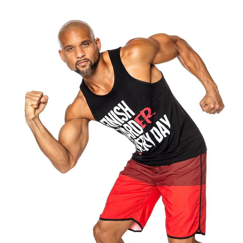 Shaun T posing in a professional photo shoot looking muscular and fit
