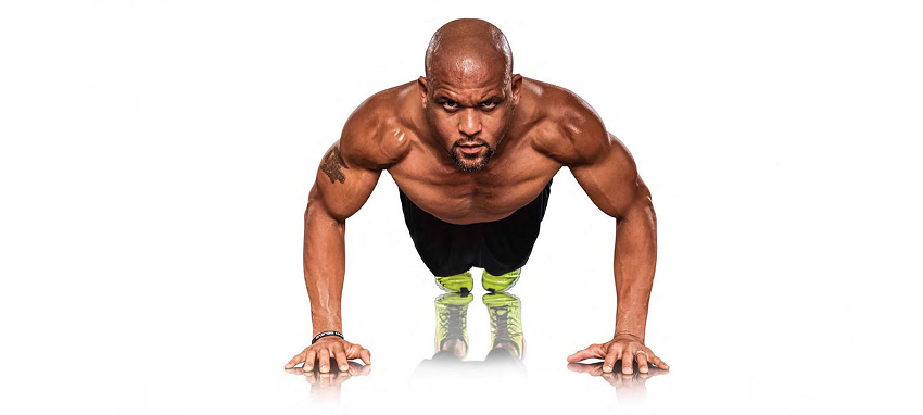 Shaun T doing pushups looking strong and fit