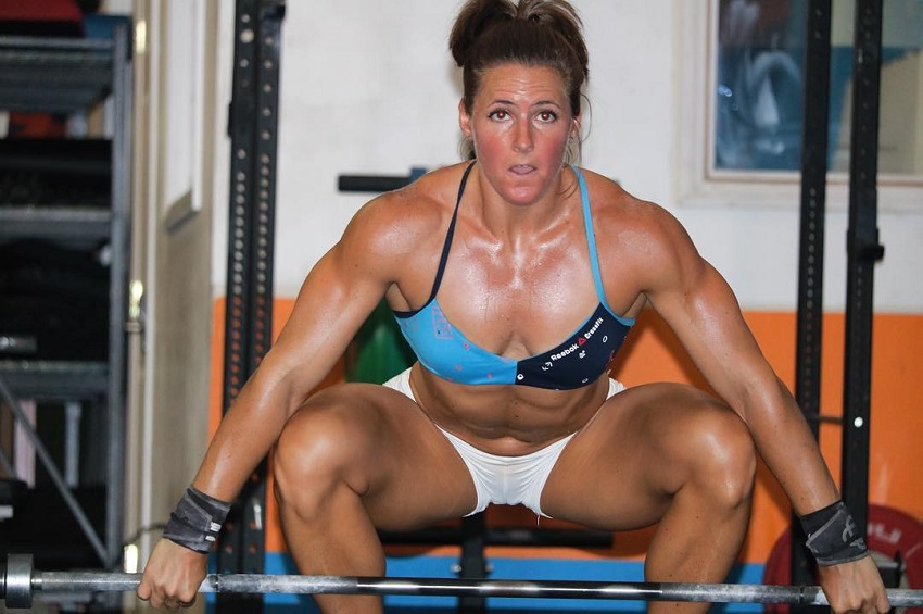 Stacie Tovar preparing to do heavy deadlifts looking fit and strong