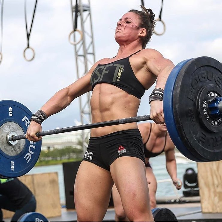 Stacie Tovar lifting heavy barbell during a CrossFit contest