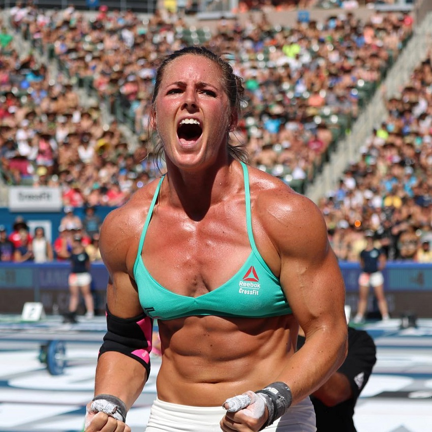 Stacie Tovar yelling from excitement during a CrossFit competition, looking muscular and lean
