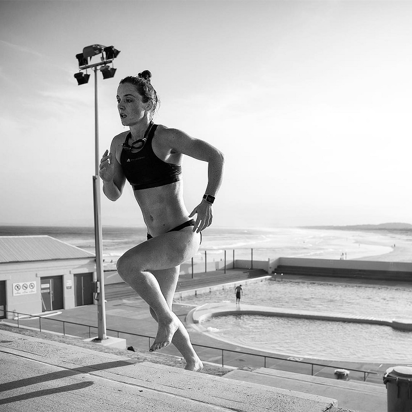 Tanya Poppett running up the stairs by the beach looking fit and strong