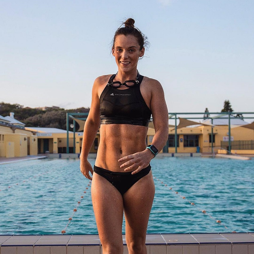 Tanya Poppett standing outdoors by a pool looking fit and healthy