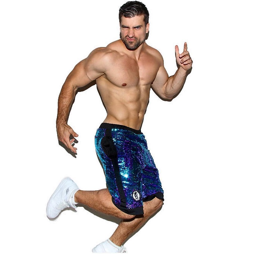 Thomas Canestraro in a professional photo shoot looking lean and muscular