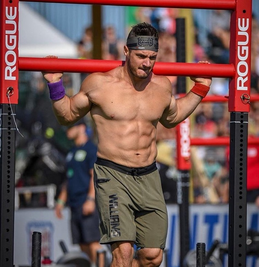 Travis Williams carrying heavy weights in a CrossFit contest