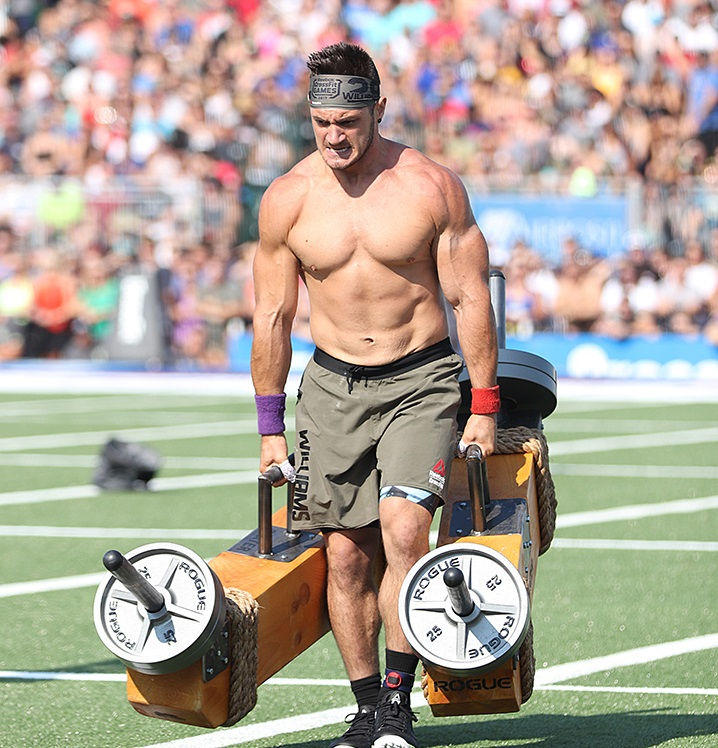 Travis Williams carrying heavy weights during a CrossFit competition