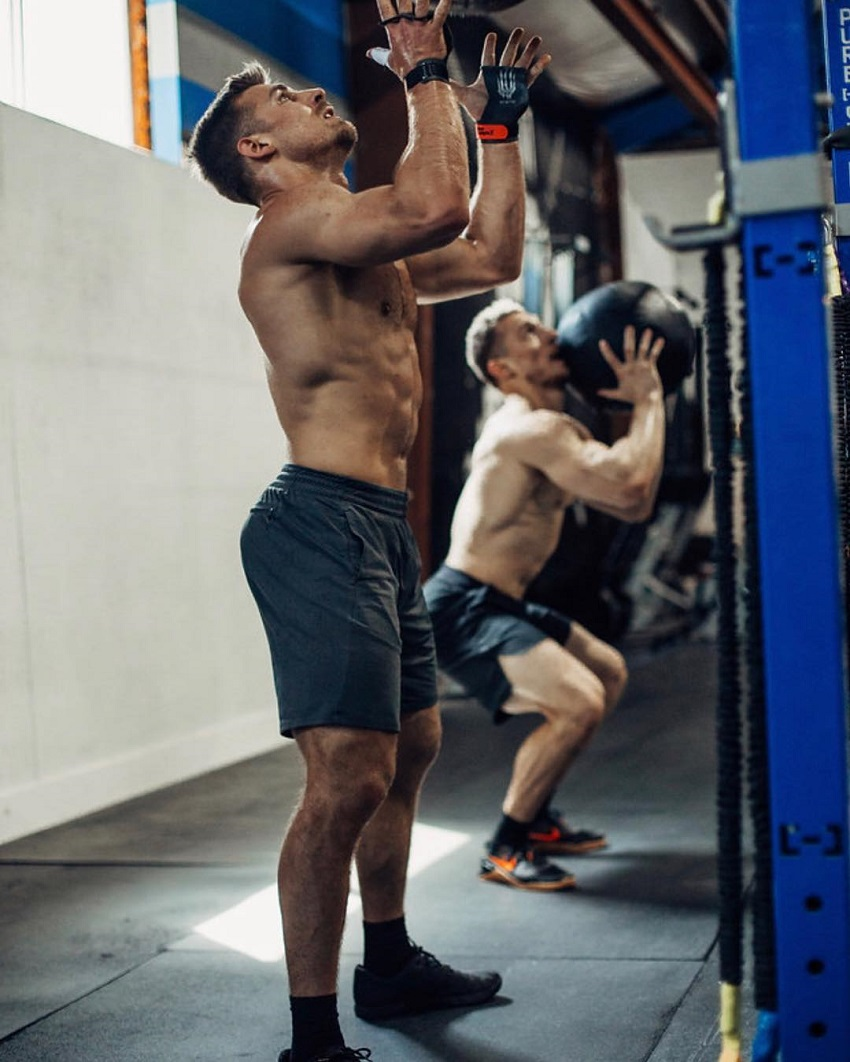 Alex Anderson performing a bag exercise during CrossFit training