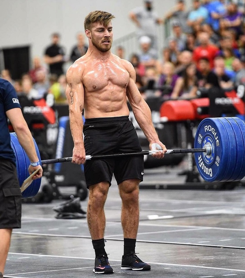 Alex Anderson lifting heavy barbell deadlifts during a CrossFit event