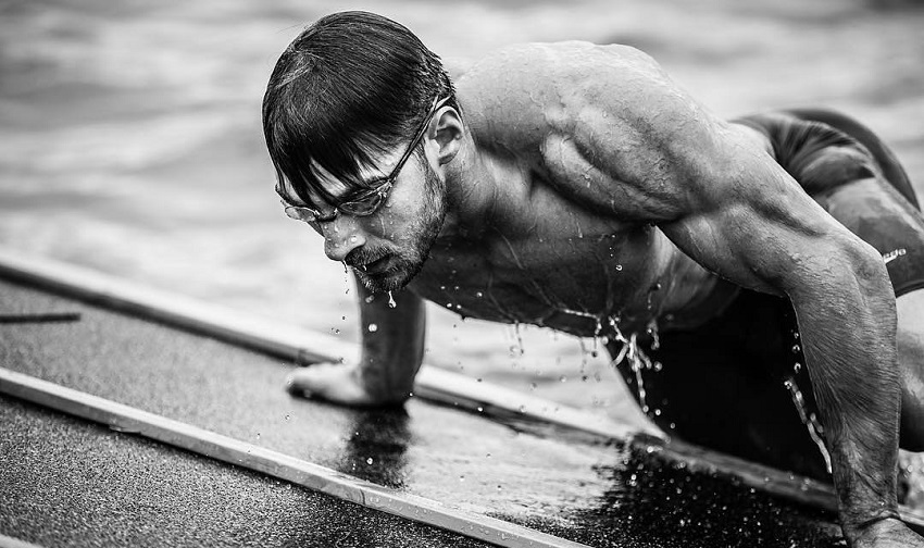 Alex Anderson getting out of a pool during a CrossFit competition
