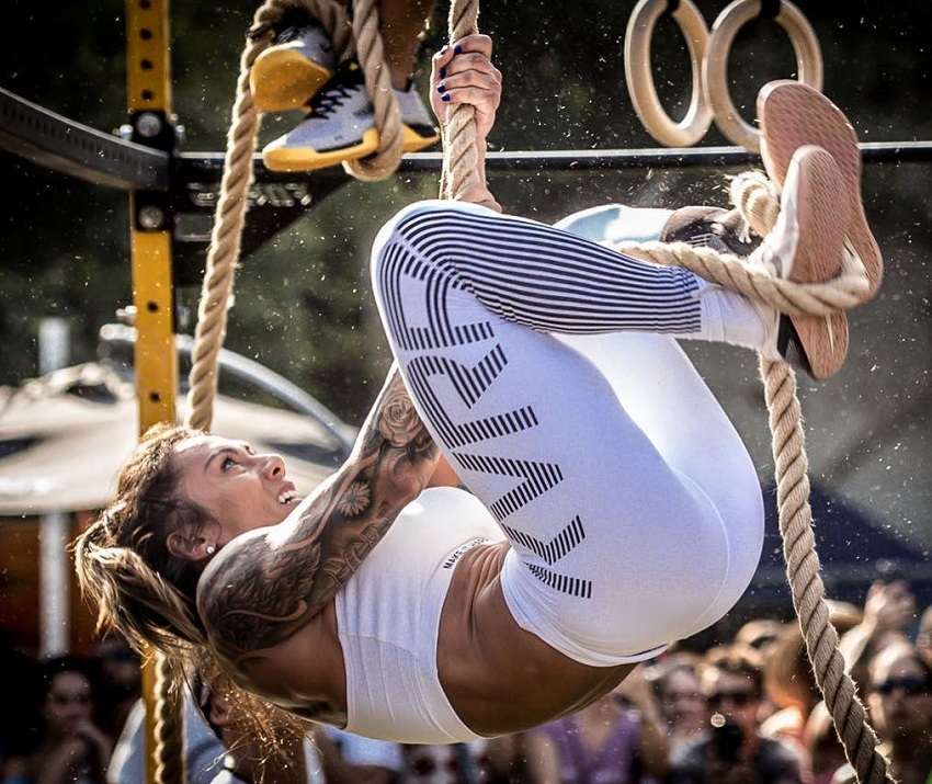 Carolinne Hobo climbing rope during a CrossFit event